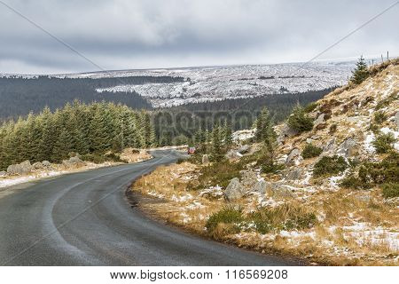 Snowy White Landscape With A Winding Road In Wicklow Gap