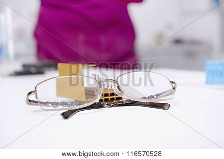 Eyeglasses On A Dentist's Table