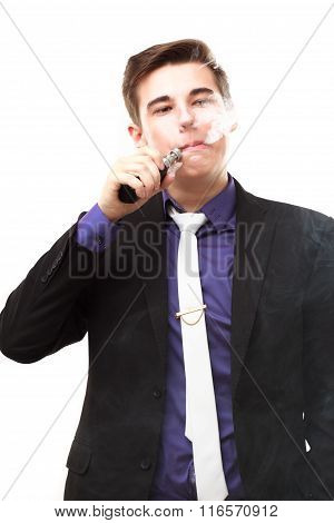 Portrait Of A Man In Suit Smoking An E-cigarette Isolated On White
