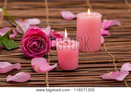 Two Pink Candles and rose ,Petals on mat