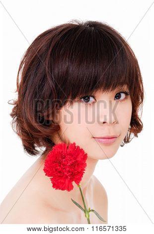 Asian woman beauty face closeup portrait with carnation