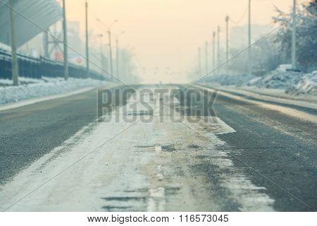 The Background, Road On An Empty Street In City, Cold Winter Day With Snow And Reagents At Dusk, Aer