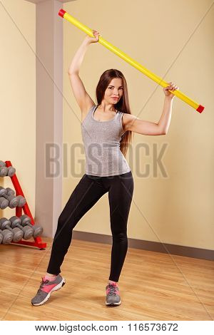 Girl Athlete Warming Up With Fitbar.