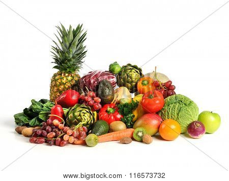 Assortment of fruits and vegetables on white table