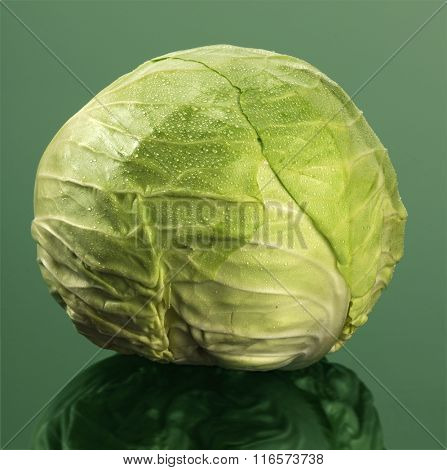 Head of cabbage on reflective table