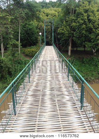 Bamboo Bridge Over River In Rain forest