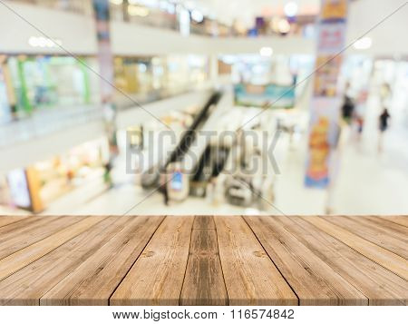 Wooden Board Empty Table blur in department store - can be used for display or montage your products