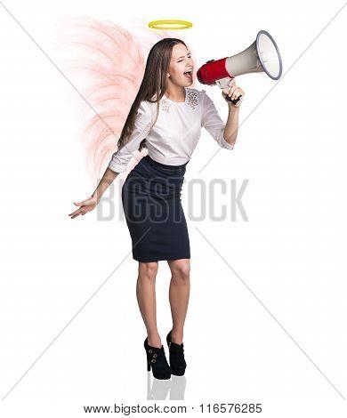 Business woman angel screams to megaphone