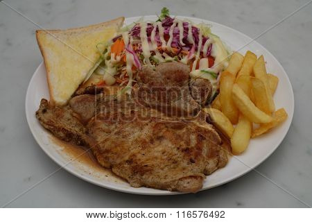 Pork chop with french fries