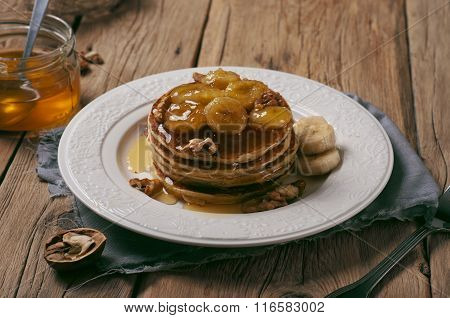 Homemade Pancake With Honey, Nuts And Caramelized Bananas