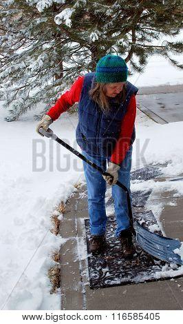Mature female shoveling.