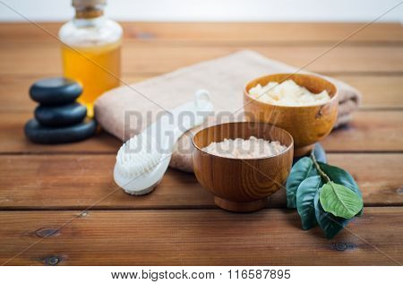close up of salt, massage oil and bath stuff
