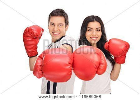 Studio shot of a young man and woman posing with red boxing gloves isolated on white background
