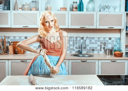Kitchen Is Woman At Table And Preparing Dinner.