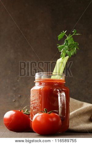 Fresh tomato juice in a glass jar on the table