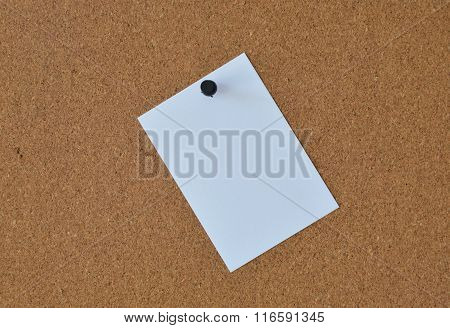 white papers note stick on wooden board