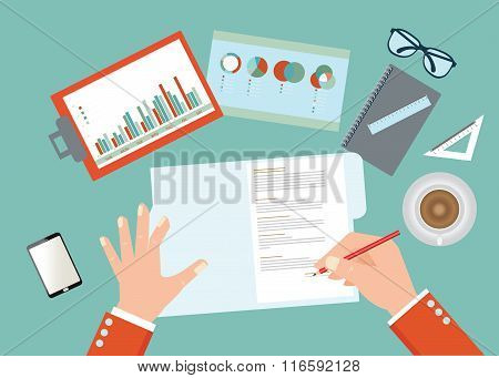 Human Hand Holding A Pencil And Signing Contract On Work Place.