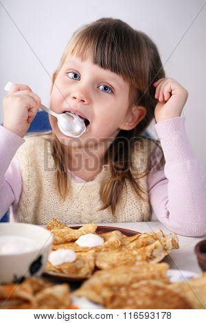 girl licking cream
