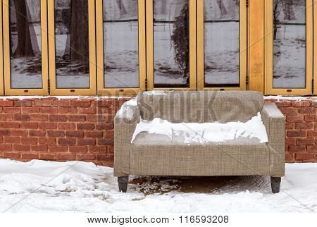 Snow Sofa Near A Brick Wall And Windows