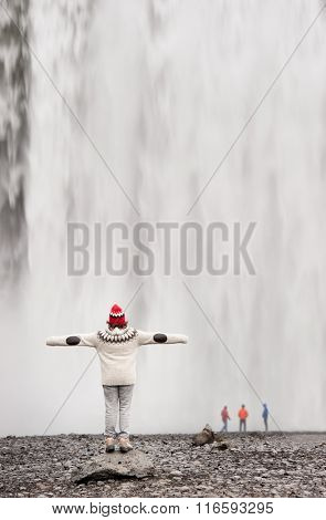 tourist enjoying the Skogafoss waterfall in iceland