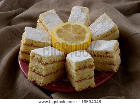 Snow White cake with vanilla and lemon, pieces, top view
