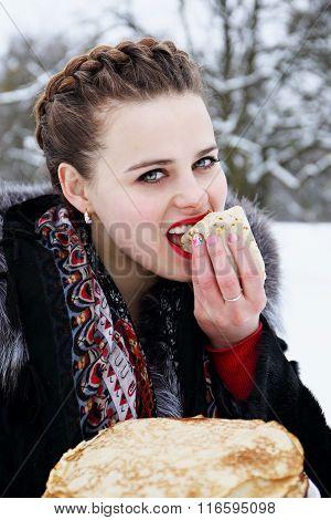 woman eats a pancake