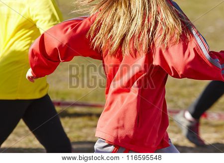 Young Female Athletics Runners On A Race. Outdoor Circuit.