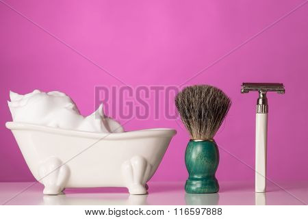 Shaving Equipment On Wooden Table And Pink  Background