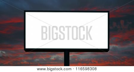 Blank billboard at sunset time ready for advertisement. Wide, cloudy sky on background, front view.