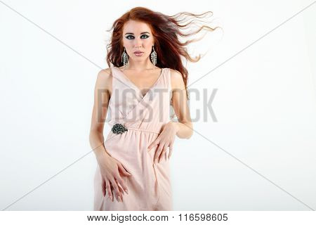 Beautiful Young Girl With Flying Hair With Beige Dress With Hands On Waist