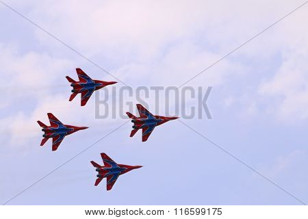 Perm, Russia - Jun 27, 2015: Four Mig 29 Fighter Planes Team Swifts Fly In Sky On Airshow Wings Of P