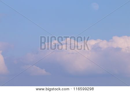 Big White Tufted Cloud In Blue Sky And Moon During Summer Day