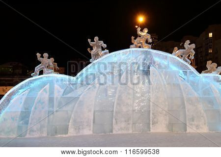Perm, Russia - Jan 26, 2015: Ice Sculpture With Running Men In Ice Town
