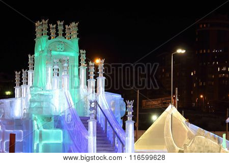 Perm, Russia - Jan 26, 2015: Ice Castle With Colored Illumination And Slides In Ice Town