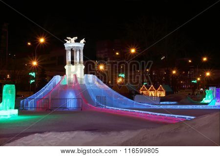 Perm, Russia - Jan 26, 2015: Ice Slide With Bright Illumination In Ice Town
