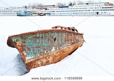 Ships And Rusry Boat In Frozen River Covered With Snow In Winter Day