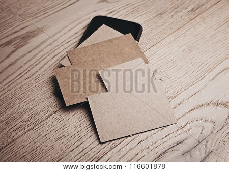 Set of blank business cards on wood table and smartphone