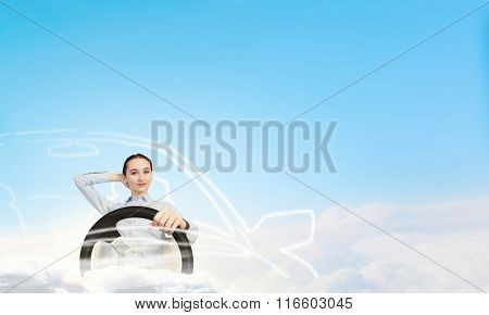 Woman with steering wheel