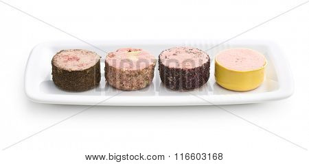 meat pate with different flavors on white background