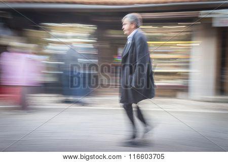 Slow blur motion people walking on the street