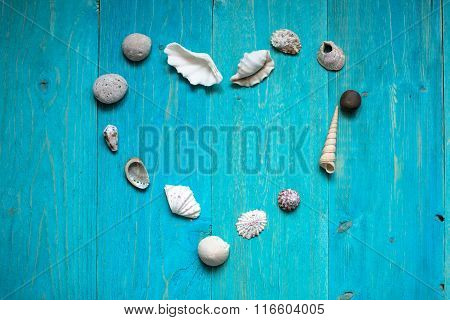 Heart Of Seashells On A Blue Wooden Background