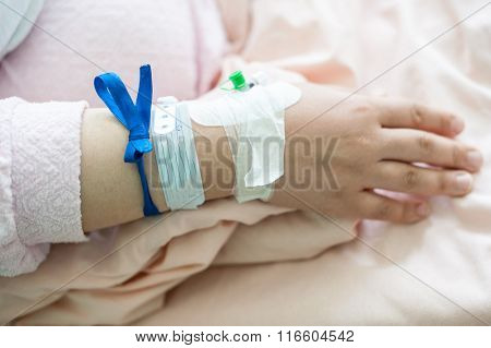 Newborn baby in hospital with identification bracelet tag name