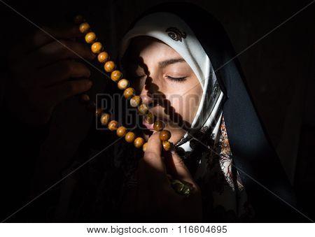 Beautiful Muslim young woman in darkness