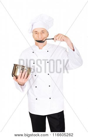 Chef in white uniform tasting his soup
