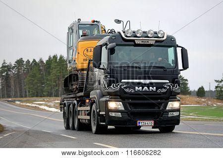 MAN TGS 35.540 Truck Hauls Excavator