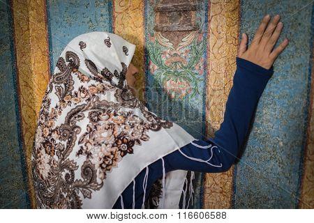 Beautiful Muslim young woman praying in masjid