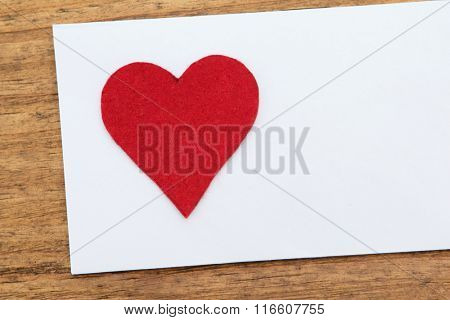 Blank sticky note with a red heart