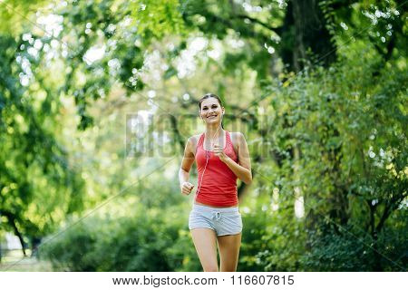 Beautiful Young Jogger In Park