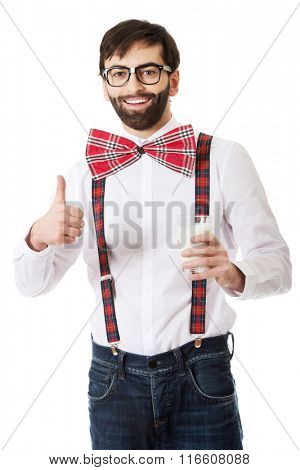 Man wearing suspenders with glass of milk.