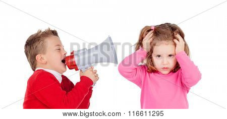 Funny little boy talking to his sister through a megaphone. Isolated on white background
